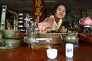 31 May 2007 - Mae Salong, Thailand - A young woman pours tea inside one of the first tea shops in Mae Salong. Photo credit: Luke Duggleby