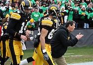 08 NOVEMBER 2008: Iowa Offensive Coordinator Ken O'Keefe leads out the offense for warmup before an NCAA college football game against Penn State, at Kinnick Stadium in Iowa City, Iowa on Saturday Nov. 8, 2008. Iowa beat Penn State 24-23.