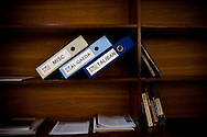 "ISLAMABAD, PAKISTAN - OCTOBER 30: Folders labled ""Taliban"", ""Al-Qaeda"" and ""Misc"" line the shelf of Pakistan's Federal Investigation Agency (FIA) Director General's office on October 30, 2008, in Islamabad, Pakistan. Since former president Musharraf's dismissal of the chief justice in early 2007, Pakistan has rapidly declined into chaos as pro-Taliban militants took advantage of the government's weaken position by stepping up attacks on government and military targets, taking control of large swaths of land, and implementing Sharia law. Pakistan suffers nearly daily attacks by militants seeking to extend their rule, destabilize the government and spread fear amongst the populace. As political infighting continues within the Pakistani leadership, authorities seem all but powerless in their fight against the militants. The US continues to denounce Pakistan ISI (Inter Services Intelligence) complacency and complicity with the Taliban, while operate unilaterally with drone attacks against targets of opportunity throughout the tribal and border region. US President Barack Obama authorized the deployment of more than 17,000 more troops to Afghanistan in an attempt to combat the Taliban resurgence. (Photo by Warrick Page)"