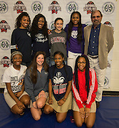 Lamar High School girls pose for a photograph during Athletic Signing Day at the Pavilion, February 1, 2017.