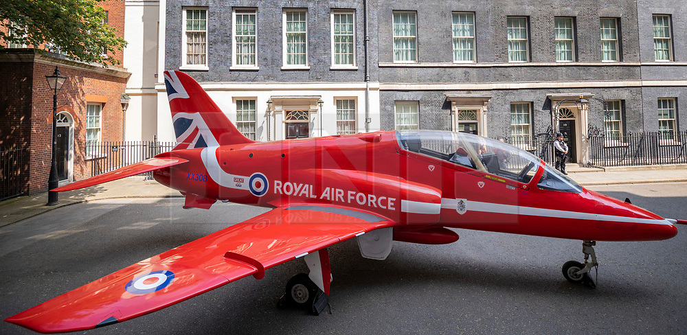 © Licensed to London News Pictures. 23/05/2018. London, UK. A Royal Air Force (RAF) Red Arrow jet on Downing Street to mark the RAF Centenary. Photo credit: Rob Pinney/LNP