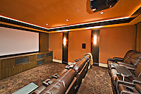 Empty media room with leather furniture in luxury mansion