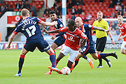 Gary MacKenzie tries to stop Romaine Sawyers during the Sky Bet League 1 match between Walsall and Doncaster Rovers at the Banks's Stadium, Walsall, England on 12 September 2015. Photo by Alan Franklin.