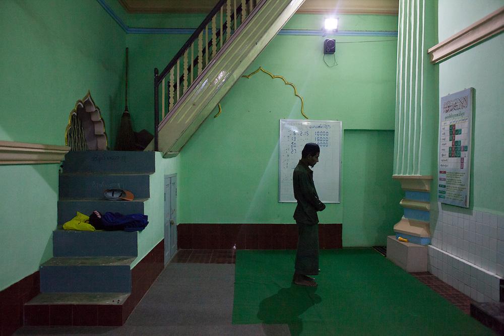 A man prays at a mosque in Meiktila, Myanmar.