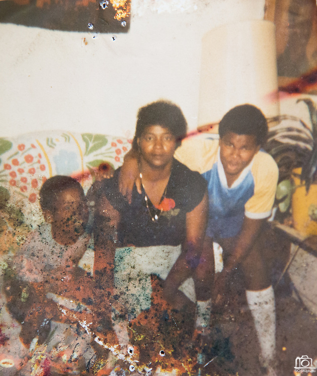 ***Photo Requested by Clarence E. Hill, Jr.***<br /> <br /> An old photo of former Dallas Cowboys guard Larry Allen, Jr. (right), his mother Vera Allen (center), and younger brother Von, photographed at his home in Danville, California, on June 27, 2013.  Allen will be inducted into the NFL Hall of Fame during the Enshrinement Ceremony at Fawcett Stadium in Canton, Ohio, on August 2, 2013. (Stan Olszewski for Fort Worth Star-Telegram)