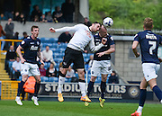 Richard Keogh wins a header against Nicky Bailey during the Sky Bet Championship match between Millwall and Derby County at The Den, London, England on 25 April 2015. Photo by David Charbit.