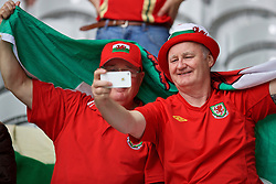 LILLE, FRANCE - Friday, July 1, 2016: Two Wales supporters take a selfie before the UEFA Euro 2016 Championship Quarter-Final match against Belgium at the Stade Pierre Mauroy. (Pic by David Rawcliffe/Propaganda)
