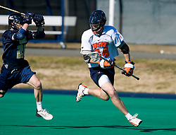 Virginia defenseman Mike Timms (44) runs past Navy midfielder Marty Gallagher (26).  The Virginia Cavaliers scrimmaged the Navy Midshipmen in lacrosse at the University Hall Turf Field  in Charlottesville, VA on February 2, 2008.