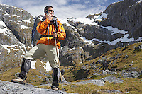 Hiker using walkie-talking on mountain