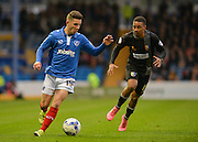 Portsmouths Conor Chaplin and Mansfield Towns Reggie Lambe battle for the ball during the Sky Bet League 2 match between Portsmouth and Mansfield Town at Fratton Park, Portsmouth, England on 24 October 2015. Photo by Adam Rivers.