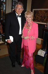 TV presenter GLORIA HUNNIFORD and her husband STEPHEN WAY at a party to celebrate the publication of an autobiography by the late Jack Rosenthal at The Fine Art Society, 148 New Bond Street, London W1 on 21st April 2005.<br />