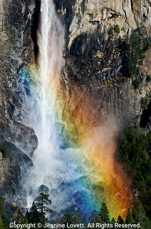 Sunlight hitting Bridalveil falls in Yosemite National Park creates a rainbow.
