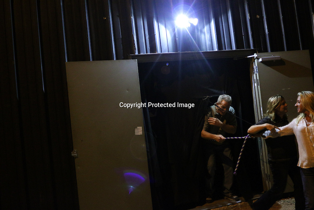 People leave holding a string to stay together Sunday October 26, 2014 at Lyceum Academy's 'Twisted' in Wilmington, N.C. (Jason A. Frizzelle)