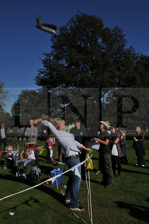 © Copyright licensed to London News Pictures. 06/10/2010. Welly wanging draws the crowds on an unseasonably warm day at Parliament Hill, Hamsptead Heath, London. The Annual Heath Heritage Festival hosts the annual Hampstead Heath Conker Competition. Representatives of the RSPB, National Trust, volunteer group Heath Hands, local beekeepers and woodworkers were in attendance.