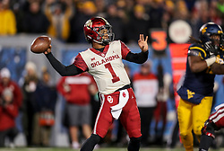 Nov 23, 2018; Morgantown, WV, USA; Oklahoma Sooners quarterback Kyler Murray (1) throws a pass during the third quarter against the West Virginia Mountaineers at Mountaineer Field at Milan Puskar Stadium. Mandatory Credit: Ben Queen-USA TODAY Sports