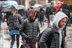 © Licensed to London News Pictures. 27/02/2020. London, UK. Commuters on their way to work in the Strand, London. Commuters are hit with snow flurries in central London this morning as the Met Office issues a yellow weather warning for snow for north of the city. Photo credit: Alex Lentati/LNP