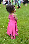 Old Westbury, New York, USA. 28th June 2015. NYLAH JEANTY, 2 1/2 years old, of Franklin Square, is dancing around the Maypole, as Lori Belilove & The Isadora Duncan Dance Company give dancing lessons to children throughout the gardens, and then perform at historic Old Westbury Gardens, a Long Island Gold Coast estate, for its Midsummer Night event.