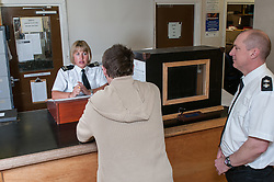 Suspect being interviewed by custody officer at police station