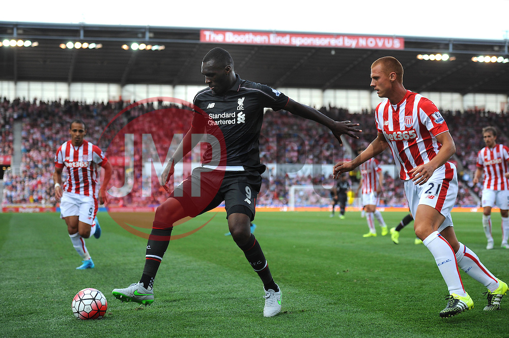 Christian Benteke of Liverpool holds the ball up from Steve Sidwell of Stoke City - Mandatory byline: Dougie Allward/JMP - 07966386802 - 09/08/2015 - FOOTBALL - Britannia Stadium -Stoke-On-Trent,England - Stoke City v Liverpool - Barclays Premier League