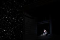 Teenage boy looks up at night sky