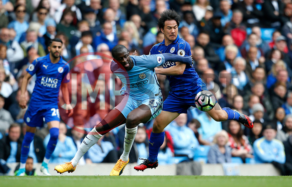 Yaya Toure of Manchester City and Shinji Okazaki of Leicester City - Mandatory by-line: Matt McNulty/JMP - 13/05/2017 - FOOTBALL - Etihad Stadium - Manchester, England - Manchester City v Leicester City - Premier League