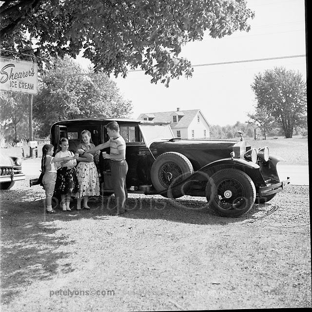 A warm summer's day in 1956. That's me pouring refreshment for my sisters on a Sunday drive in the family Rolls Royce. It's the 2nd of 3 Phantom IIs our dad, Ozzie Lyons, owned from the mid-1950s into the 1980s. From left, the girls are Pat, Claire and Sue.