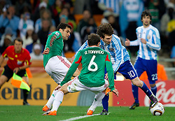 Rafael Marquez of Mexico and Gerardo Torrado of Mexico vs Lionel Messi of Argentina during the 2010 FIFA World Cup South Africa Round of Sixteen match between Argentina and Mexico at Soccer City Stadium on June 27, 2010 in Johannesburg, South Africa. (Photo by Vid Ponikvar / Sportida)