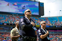 CHARLOTTE, USA - Sunday, July 22, 2018: Police stand during the playing of the national anthem before a preseason International Champions Cup match between Borussia Dortmund and Liverpool FC at the  Bank of America Stadium. (Pic by David Rawcliffe/Propaganda)