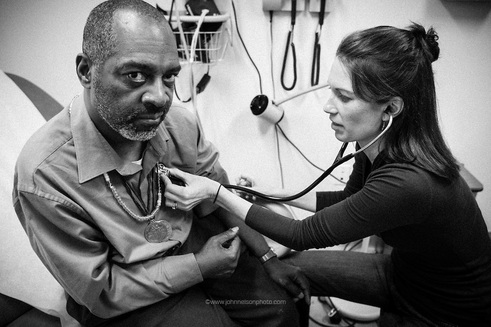 "Physician assistant Jen Vaupel listens to  Robert ""Bobby"" Young's heart during a check up at Bread for the City in Washington, DC."