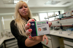 UK ENGLAND SANDWICH 25SEP14 - Wendy Greenall, Counterfeit Medicines Laboratory Manager poses with a packet of fake Viagra  for a photo at the Pfizer laboratory in Sandwich, Kent, England.<br /> <br /> <br /> <br /> jre/Photo by Jiri Rezac<br /> <br /> <br /> <br /> &copy; Jiri Rezac 2014
