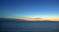Orange Sunset over blue sea.