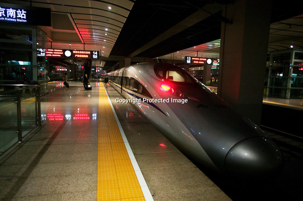 Beijing, September 11 , 2011 : passengers get off the train in Beiing. the passenger-dedicated trunk line opened in June 2011, reducing the 1,318 km journey between Beijing and Shanghai to less than 5 hours. Trains reach top speeds of 300 km/h (186 mph) for the entire trip.