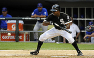 CHICAGO - JUNE 21:  Juan Pierre #1 of the Chicago White Sox lays down a safety squeeze bunt that scored Alex Rios #51 in the third inning against the Chicago Cubs on June 21, 2011 at U.S. Cellular Field in Chicago, Illinois.  (Photo by Ron Vesely)  Subject:  Juan Pierre;Alex Rios
