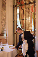 Alexi, the head waiter, setting up of tables at the Restaurant Meurice in Paris....photo by Owen Franken......May 26, 2004
