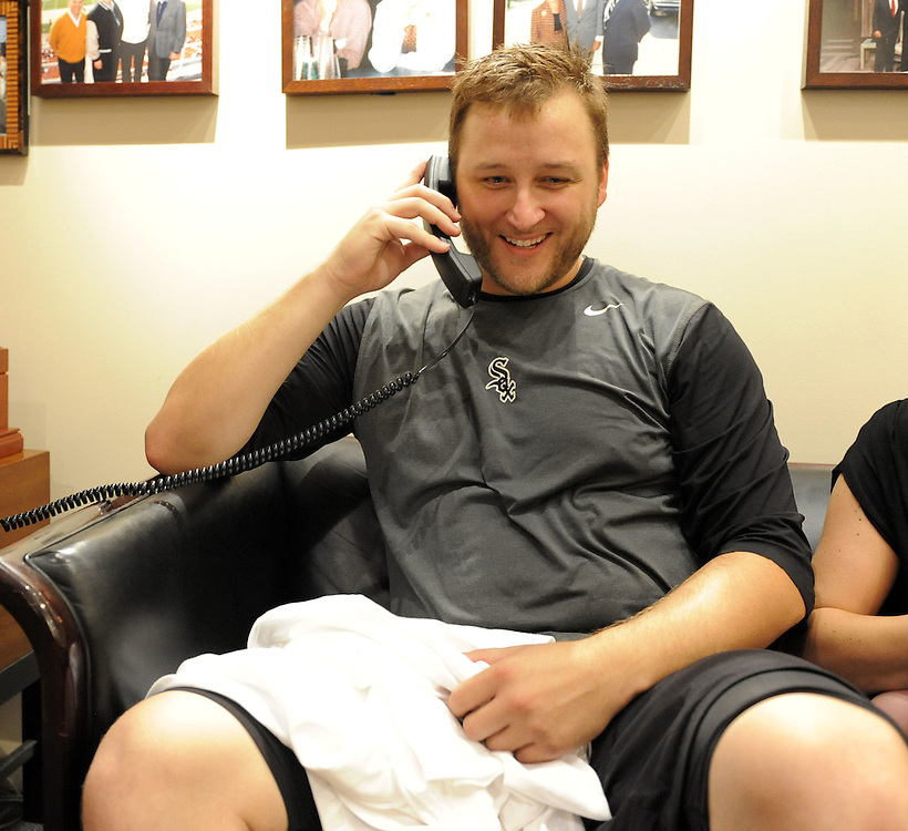 CHICAGO - JULY 23:  Mark Buehrle #56 of the Chicago White Sox talks to President Barack Obama after recording the 18th perfect game in major league history against the Tampa Bay Rays on June 23, 2009 at U.S. Cellular Field in Chicago, Illinois.  The White Sox defeated the Rays 5-0.  (Photo by Ron Vesely)