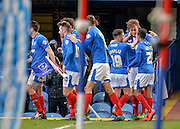 Portsmouth players celebrate Portsmouth defender Adam Webster goal during the Sky Bet League 2 match between Portsmouth and Cambridge United at Fratton Park, Portsmouth, England on 27 February 2016. Photo by Adam Rivers.
