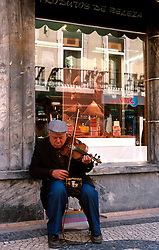 PORTUGAL LISBON MAY99 - A blind busker performs on the Rua Augusta in the Baixa district.....jre/Photo by Jiri Rezac....© Jiri Rezac 1999....Tel:   +44 (0) 7050 110 417..Email: info@jirirezac.com..Web:   www.jirirezac.com