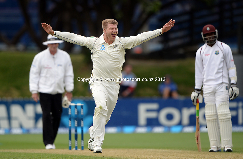 Corey Anderson celebrates the wicket of Darren Bravo on Day 2 of the 2nd cricket test match of the ANZ Test Series. New Zealand Black Caps v West Indies at The Basin Reserve in Wellington. Thursday 12 December 2013. Mandatory Photo Credit: Andrew Cornaga www.Photosport.co.nz