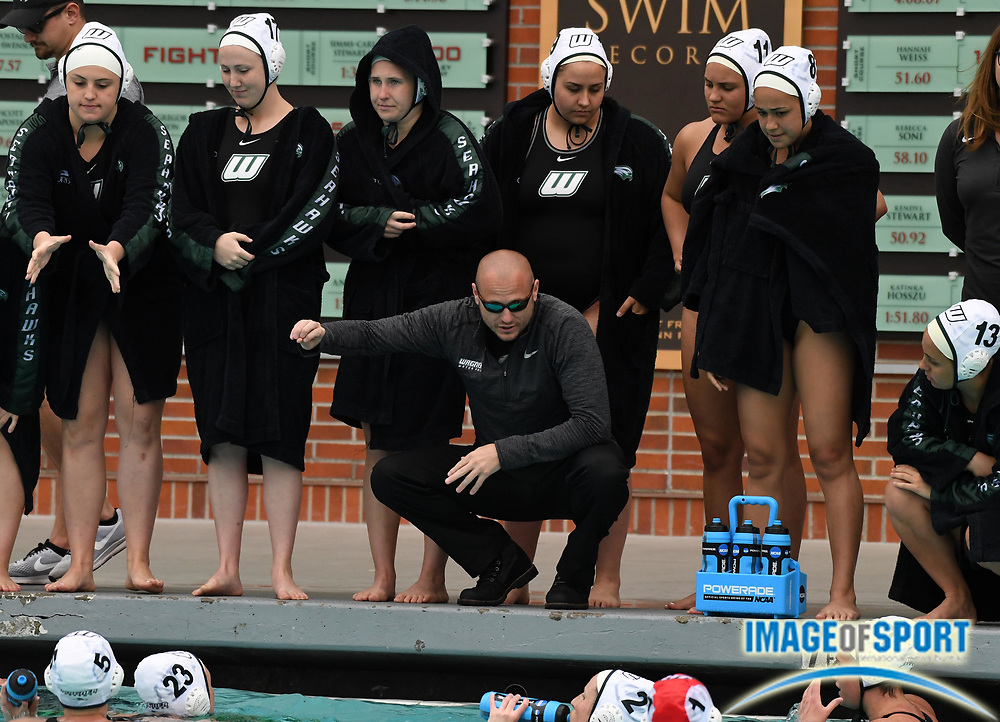 Wagner Seahawks coach Chris Radmonovich reacts during an NCAA college women's water polo quarterfinal game against the Southern California Trojans  in Los Angeles, Friday, May 11, 2018. USC defeated Wagner 12-5.  (Kirby Lee via AP)
