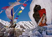 Kunzum La Pass. Himachal Pradesh, India. Prayer flags, chorten and Buddha staue.