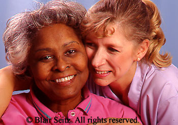 Medical Physical Therapy, Patient and Therapist, Caring Therapist Caucasian Female Therapist Shows Love and Caring to African American Patient