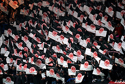 Eintracht Frankfurt fans in the stands wave flags