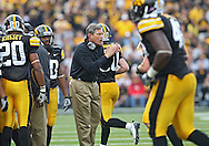 October 23 2010: Iowa head coach Kirk Ferentz applauds his team during the first half of the NCAA football game between the Wisconsin Badgers and the Iowa Hawkeyes at Kinnick Stadium in Iowa City, Iowa on Saturday October 23, 2010. Wisconsin defeated Iowa 31-30.