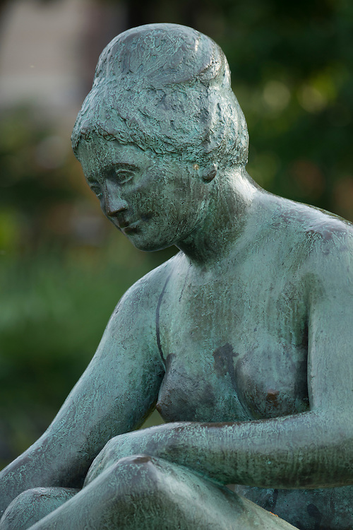 Europe; Switzerland; Ticino; Ascona, sculpture of a naked woman on the shore of Lago Maggiore