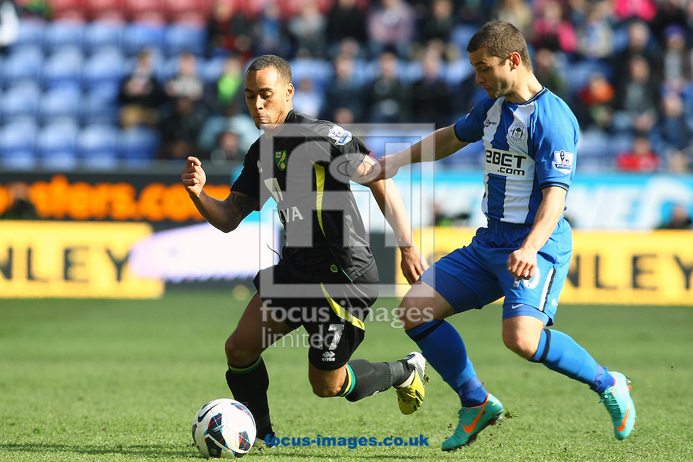 Picture by Paul Chesterton/Focus Images Ltd +44 7904 640267.30/03/2013.Elliott Bennett of Norwich and Shaun Maloney of Wigan in action during the Barclays Premier League match at the DW Stadium, Wigan.