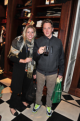 HARRY BECHER and SCARLETT GUESS at a party hosted by TLC to celebrate signing their 5000th member and Ralph Lauren to celebrate the opening of the first Ralph Lauren Rugby store in the UK at 43 King Street, Covent Garden, London on 30th November 2011.