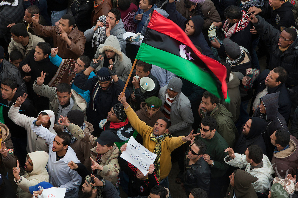 Libyan men are seen taking part in a large protest following Friday prayers February 25, 2011 in the central square of Benghazi, Libya. A crowd of at least 5,000 attended the prayers, which also included funeral prayers for three victims of the recent revolution that were laid to rest today. .Slug: Libya.Credit: Scott Nelson for the New York Times