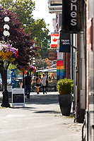 Downtown Victoria BC features colorful flower baskets along the pedestrian and bike-friendly streets.
