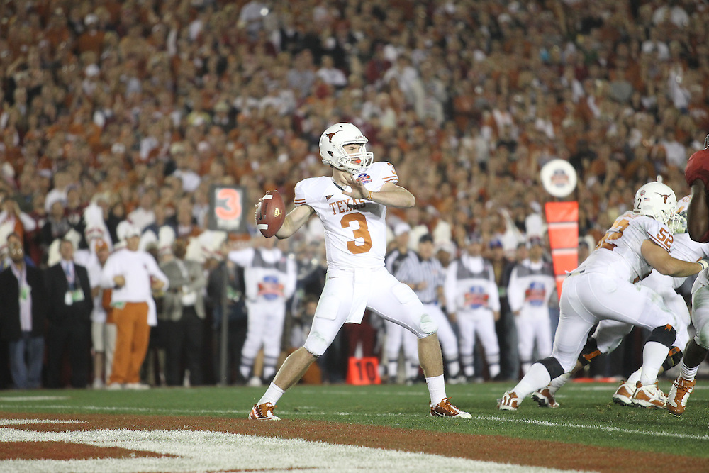 PASADENA,CA - JANUARY 07: Garrett Gilbert #3 of the Texas Longhorns drops back to pass against the Alabama Crimson Tide. The Crimson Tide defeated the Longhorns 37-21 in the Citi BCS National Championship game on January 7, 2010 at the Rose Bowl in Pasadena, CA.  Photo by Tom Hauck. PLAYER:Garrett Gilbert