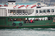 Passengers on Star Ferry, Hong Kong